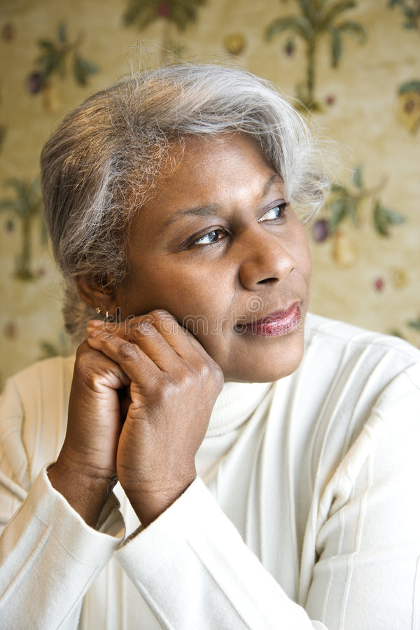 Portrait of mature woman. Portrait of mature African American woman looking to the side stock images
