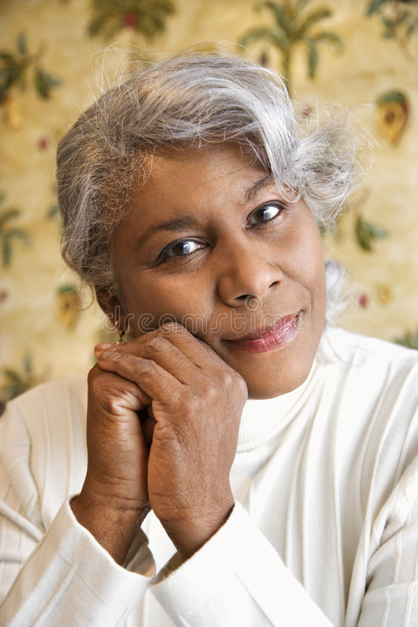 Portrait of mature woman. Portrait of mature African American woman looking at viewer royalty free stock photo
