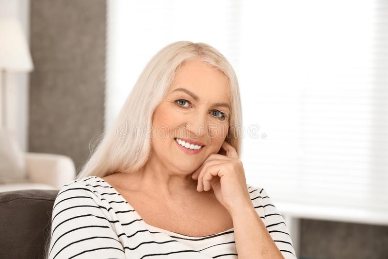 Portrait of mature woman with beautiful face. Indoors royalty free stock images