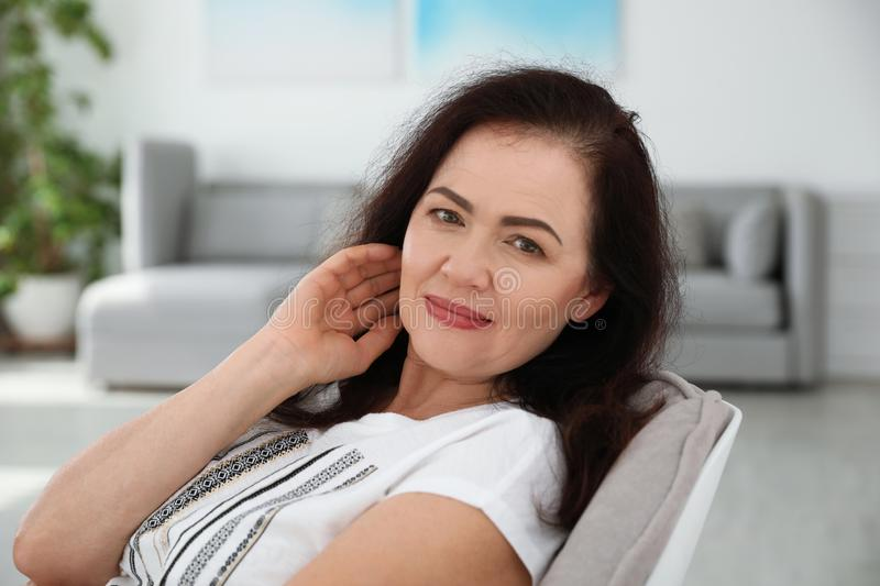 Portrait of mature woman with beautiful face. Indoors stock image