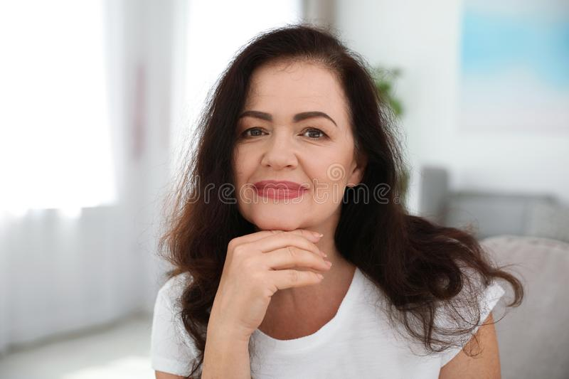 Portrait of mature woman with beautiful face. Indoors stock images