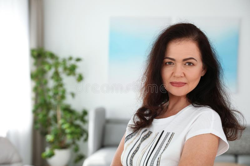 Portrait of mature woman with beautiful face. Space for text. Portrait of mature woman with beautiful face indoors. Space for text stock photos
