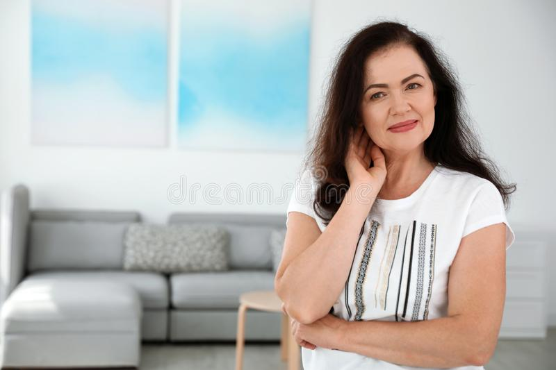 Portrait of mature woman with beautiful face. Space for text. Portrait of mature woman with beautiful face indoors. Space for text stock photo