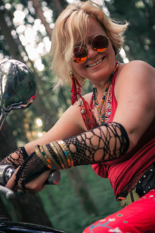 Portrait of Mature Woman Biker royalty free stock image