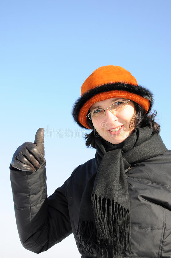 Portrait of mature woman giving thumb up