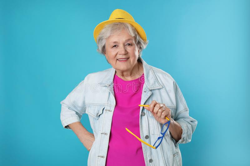 Portrait of mature woman in hipster outfit stock photos