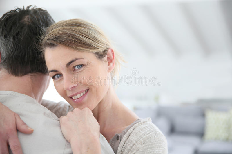 Portrait of mature woman hugging her husband royalty free stock photography