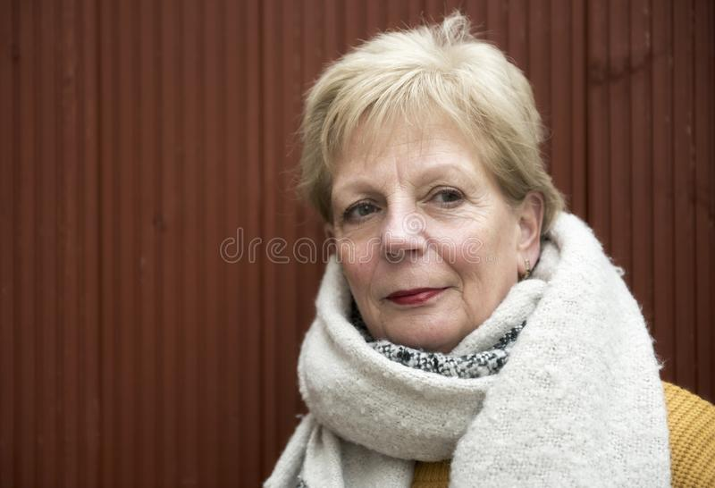 Portrait of a mature woman outdoors in winter with a large scarf. Taken with copy space stock photos