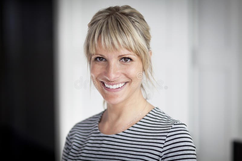 Portrait Of A Mature Woman Smiling At The Camera stock photography