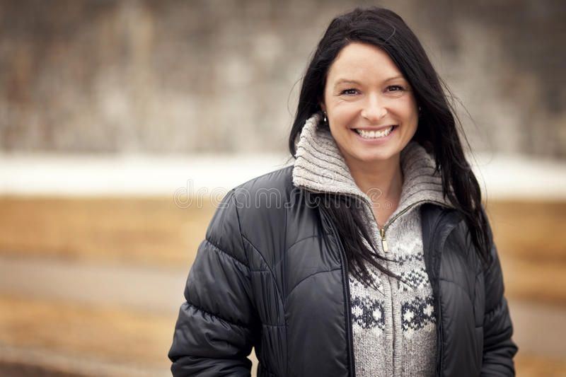 Portrait Of A Mature Woman Smiling. Portrait Of A Mature Native Woman Smiling royalty free stock photos