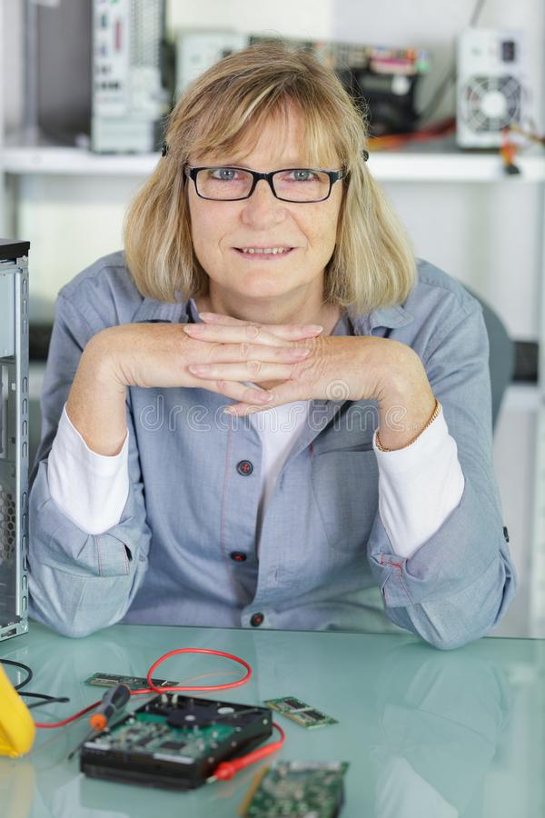 Portrait mature woman technician royalty free stock images