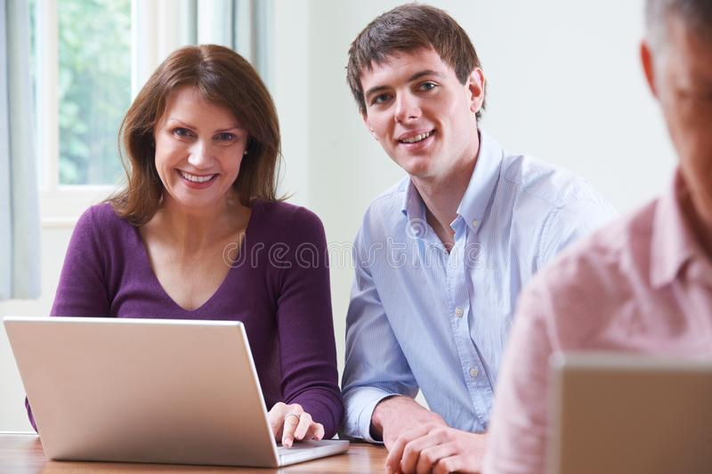 Portrait Of Mature Woman With Tutor In Adult Education Class royalty free stock image