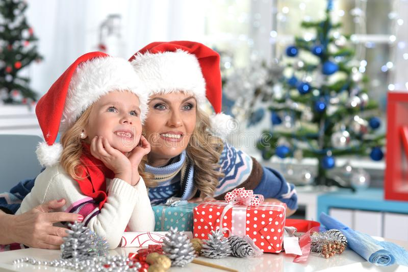 Portrait of woman and child girl celebrating Christmas royalty free stock photo