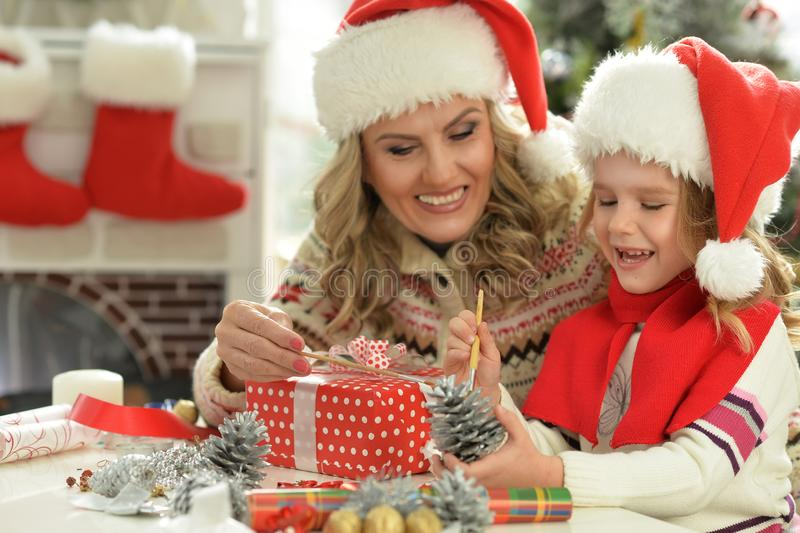 Portrait of woman and child girl celebrating Christmas royalty free stock image