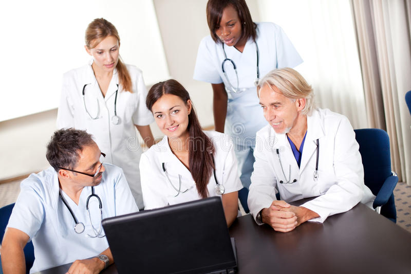 Portrait of mature young doctors working together royalty free stock images