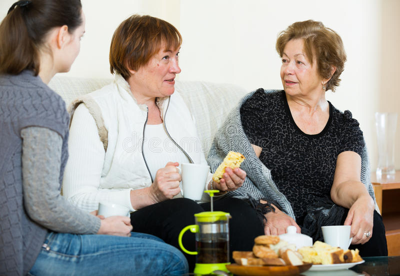Portrait of mature and young women with tea. Portrait of mature and young women drinking tea and laughing stock images