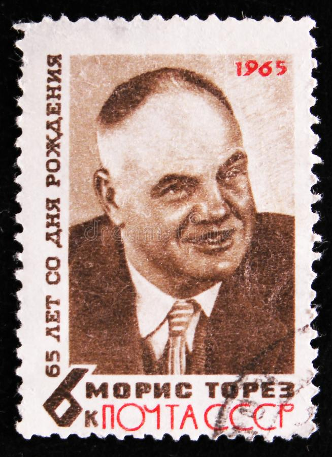 Portrait of Maurice Thorez - leader of French Communist Party, 65th Birth Anniversary, circa 1965. MOSCOW, RUSSIA - APRIL 2, 2017: A post stamp printed in USSR royalty free stock images