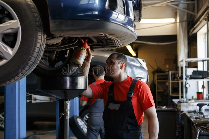 Portrait of a mechanic at work in his garage stock image