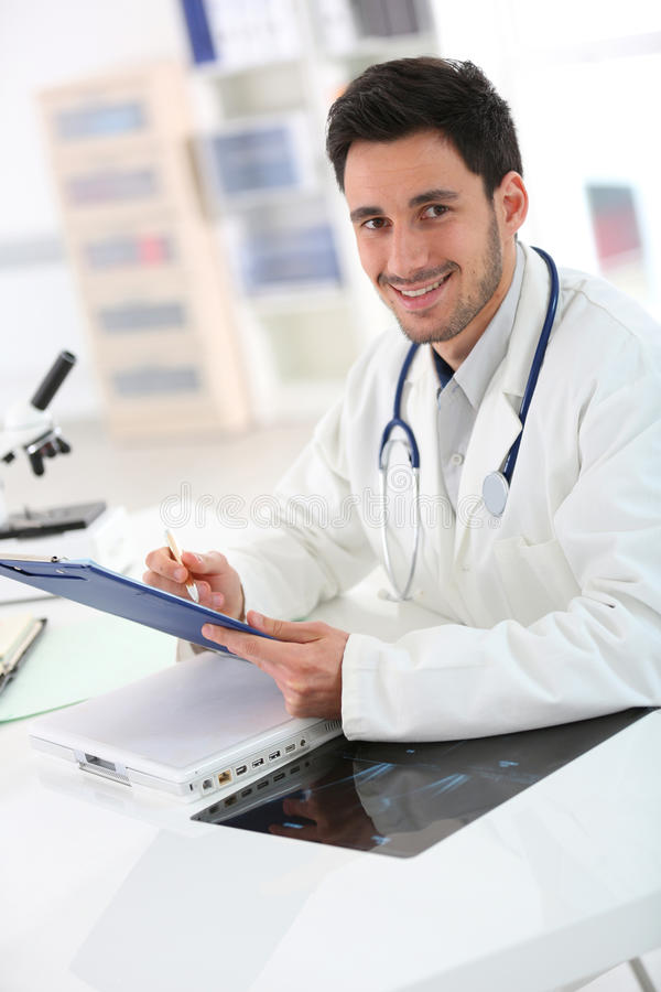 Portrait of medecine student. Portrait of student in medicine working in hospital royalty free stock photo
