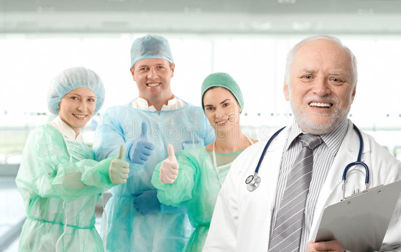 Portrait of medical professor and team stock images