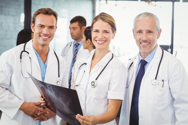 Portrait of medical team holding a x report royalty free stock images