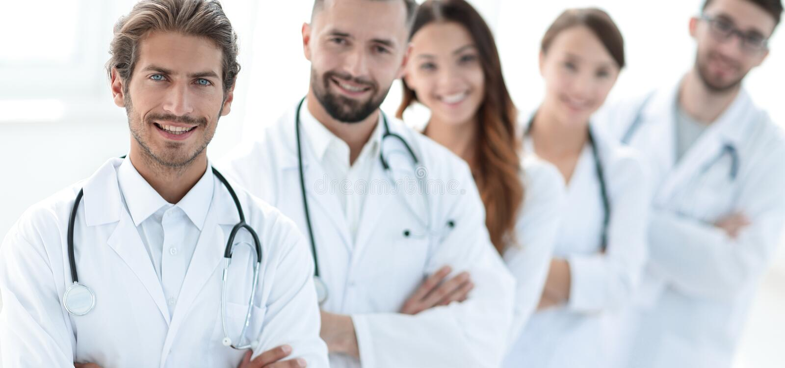 Portrait of medical team standing with arms crossed in hospital. Concept of health stock photos