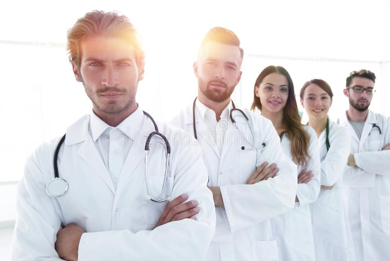 Portrait of medical team standing with arms crossed in hospital. Concept of health royalty free stock images