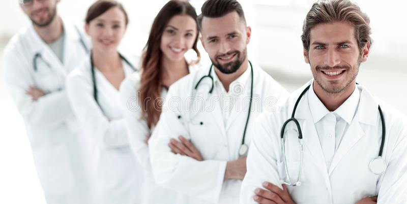 Portrait of medical team standing with arms crossed in hospital royalty free stock photos