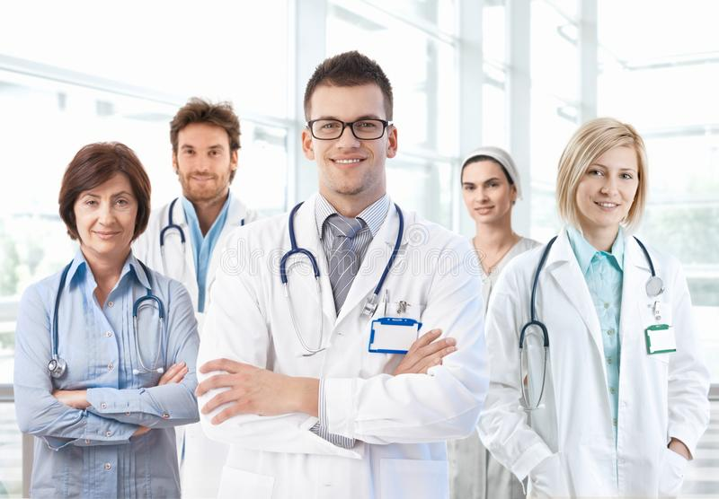 Portrait of medical team standing in hospital royalty free stock photography