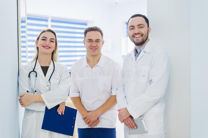 Portrait of medical team standing in hospital hall stock photo