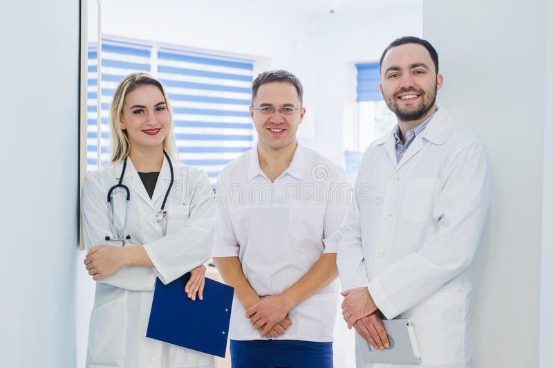 Portrait of medical team standing in hospital hall stock image