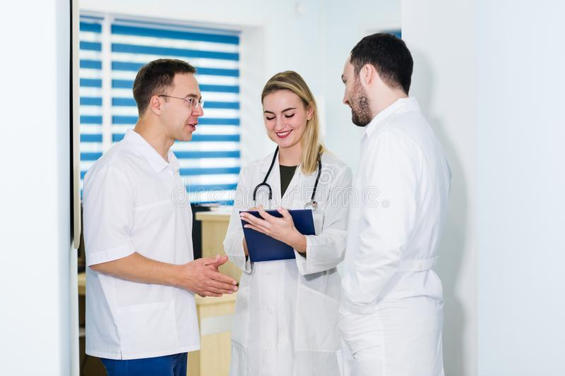 Portrait of medical team standing in hospital hall royalty free stock photography
