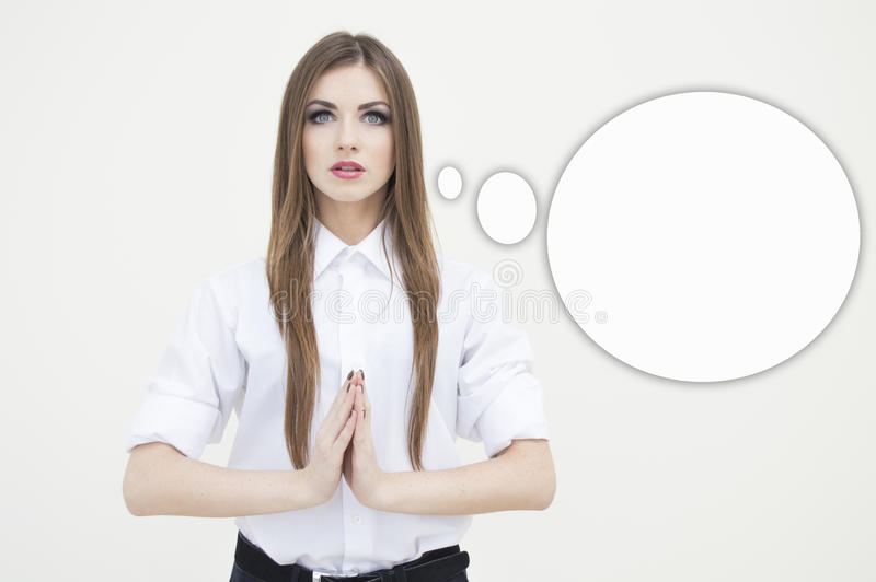 Portrait of meditating business woman on white copyspace and bubble stock image