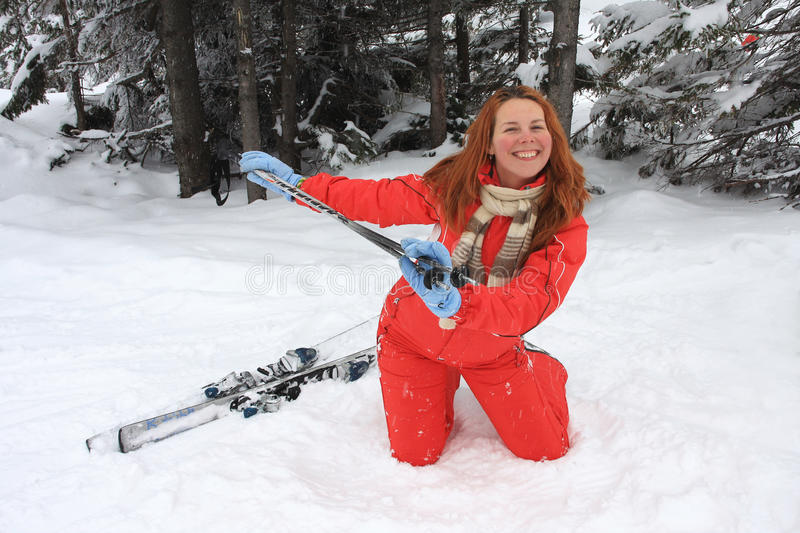 Portrait of merry young woman of skier royalty free stock photo