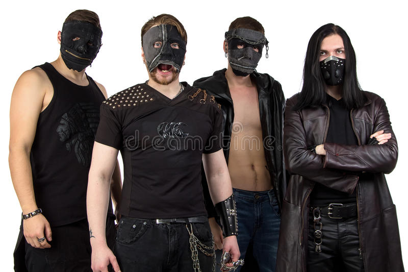 Portrait of the metal band in black clothes. On white background royalty free stock photo
