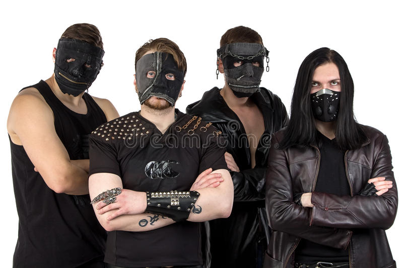 Portrait of the metal band in masks. On white background royalty free stock photography