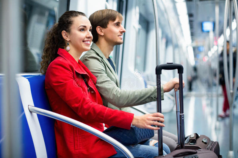 Portrait of metro passengers sitting in car seats royalty free stock image