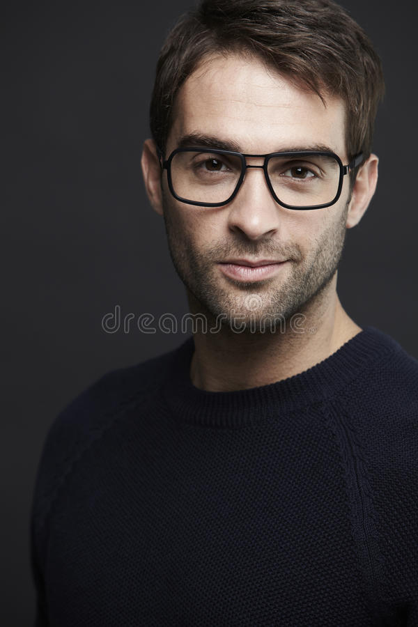 Portrait of mid adult man. Wearing glasses royalty free stock images