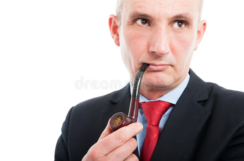 Portrait of middle age business man smoking pipe. Isolated on white background with copy text space royalty free stock photo