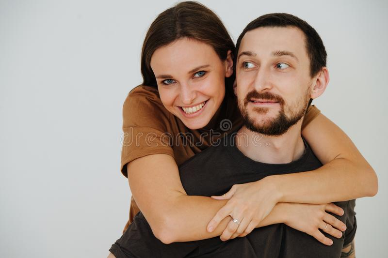 Portrait of a middle age couple having fun. Woman riding on her man`s back stock photos