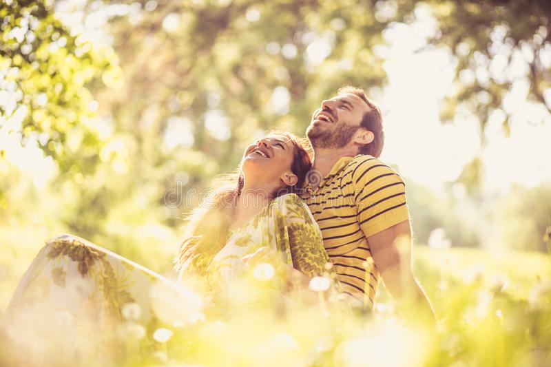 Portrait of middle age couple at nature. Happy and in love. stock photography
