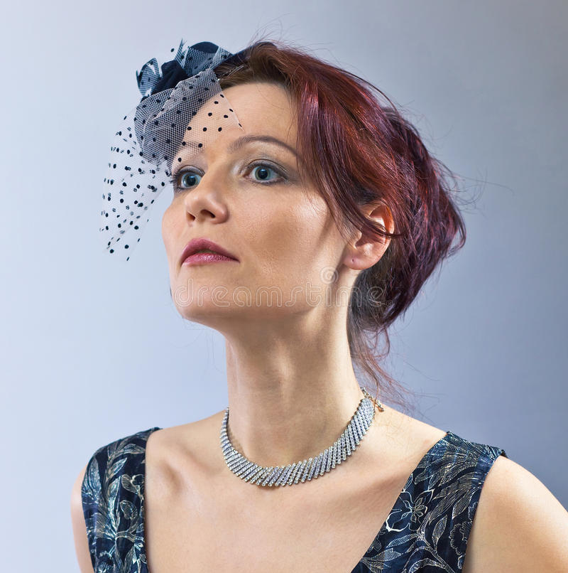 Portrait of the middle age woman. Portrait of the middle age woman in hat with veil royalty free stock photography