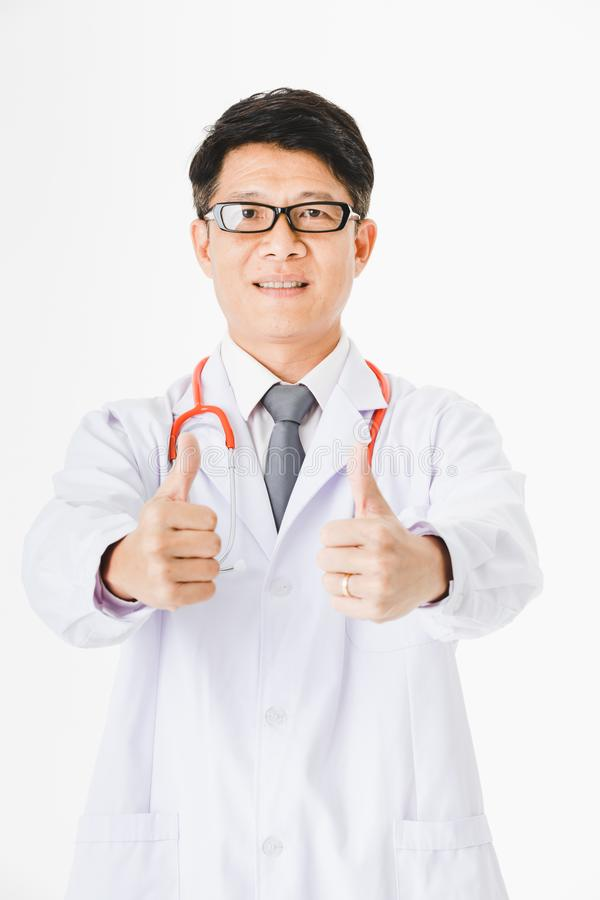 Asian doctor on isolated white. Portrait of Middle aged, handsome, Asian, doctor, on duty at hospital stethoscope around his neck, proudly posing thumb up sign royalty free stock image
