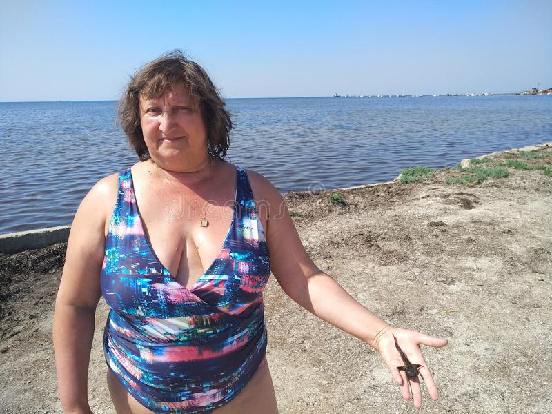 Portrait of a middle-aged woman on the beach stock photos