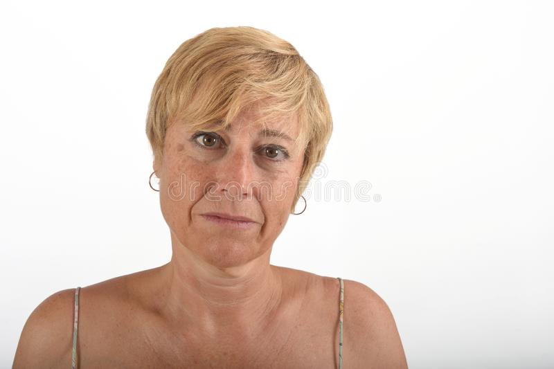 Portrait of a middle aged woman on white stock photos