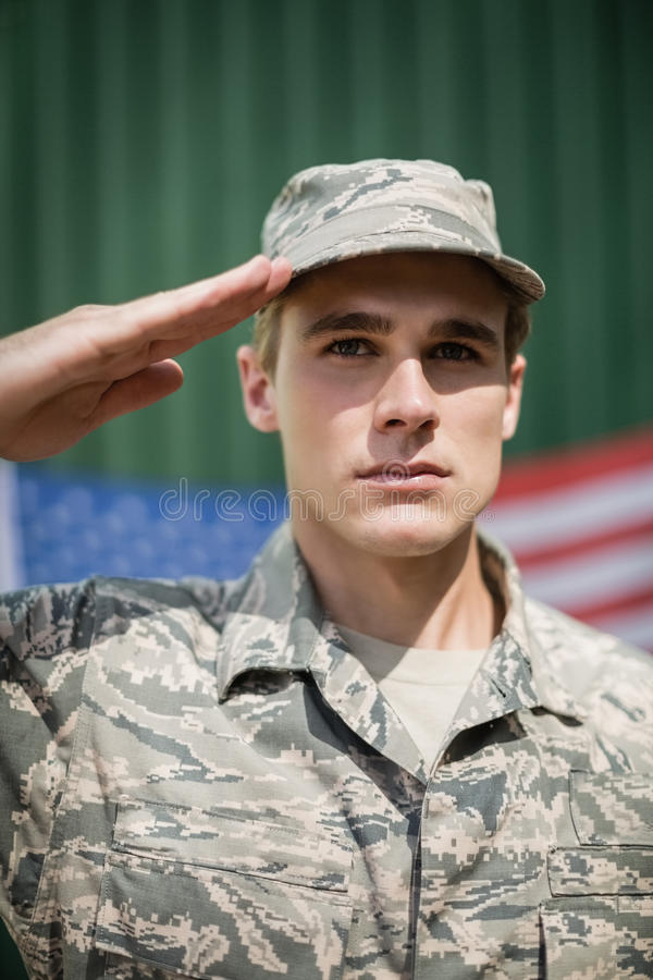 Portrait of military soldier giving salute royalty free stock photos