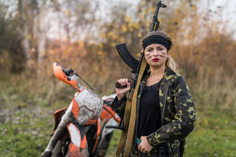 Portrait of military woman holding rifle outdoors royalty free stock photography