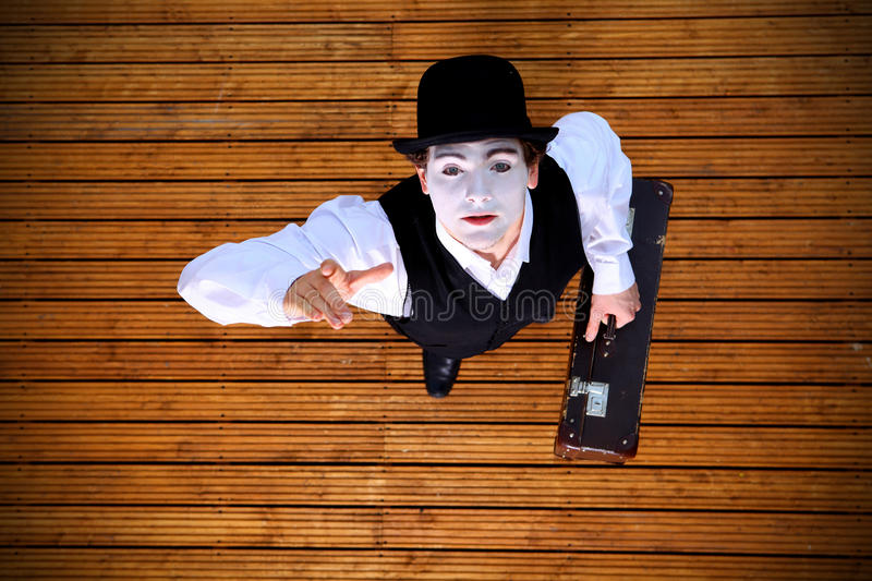 Portrait of the mime. In a make-up on wood background stock photos