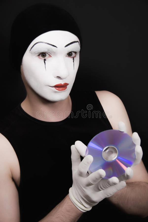 Download Portrait Of Mime With Cd On Black Background Stock Photo - Image: 12430082