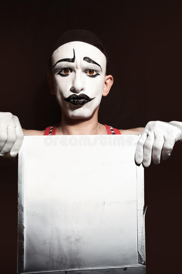 Portrait of mime holding white dirty sheet in hands royalty free stock images
